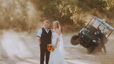 Moment groomsman 'crashes' wedding photoshoot