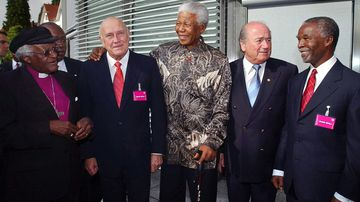 South Africa delegates in May 2004, including Nelson Mandela (centre) and FIFA President Sepp Blatter (second from right). Multiple FIFA executives are facing allegations they accepted huge bribes in order to grant the 2010 World Cup to the African nation. (AAP)