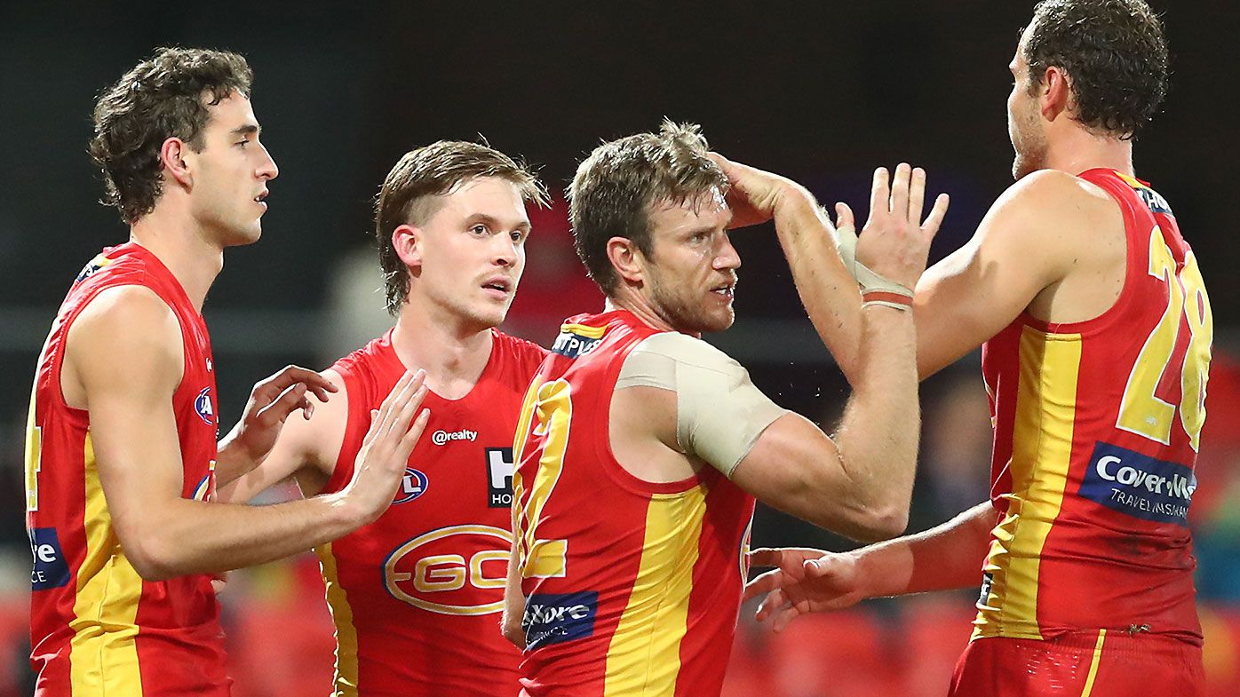 Gold Coast Suns players 'shattered' at the departure of popular assistant coach Dean Solomon