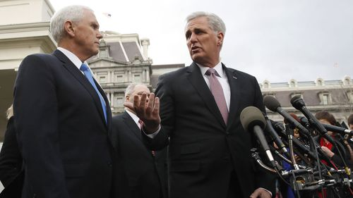 House Minority Leader Kevin McCarthy, gestures to Vice President Mike Pence, left, after meeting with President Donald Trump and Democratic leaders on border security, as the government shutdown continues.