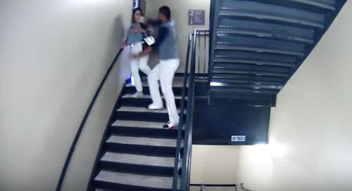 The footage shows Vasquez walk the woman into the stairwell before striking her several times. (Supplied)