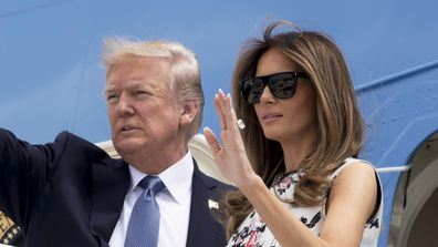US President Donald Trump and First Lady Melania Trump board Air Force One prior to departing Paris Orly Airport on July 14, 2017. (AFP)