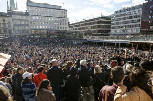 Thousands honoured the beloved DJ with a minute of silence at Sergel torg in central Stockholm. (AAP)