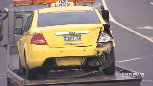 Incredibly, neither the taxi driver nor Rob were injured in the crash. (9NEWS)