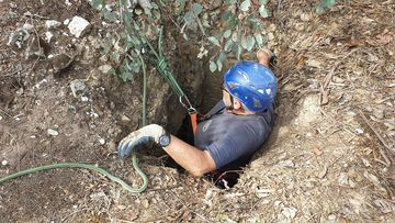 The min shaft was just wide enough for the rescuer to descend.