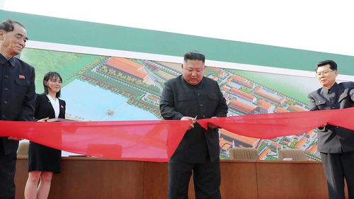 Kim Jong-un cuts a ribbon in front of his sister Kim Yo-jong, the presumed heir apparent to the dynasty.