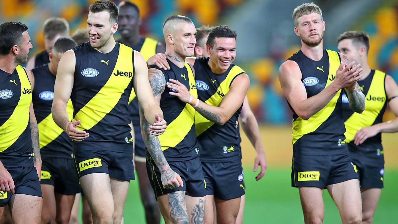 Dustin Martin and Sydney Stack (centre) celebrate a win in round 12