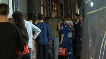 Partygoers lined up outside a bar on George Street in Sydney's CBD.