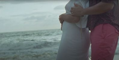 Chrissy Teigen shows her baby bump in the music video for Wild.