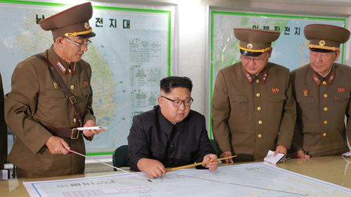 Kim Jong-un talks with North Korean military leaders. (AAP)