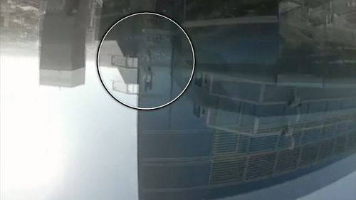 It shows another man backflipping off a building.