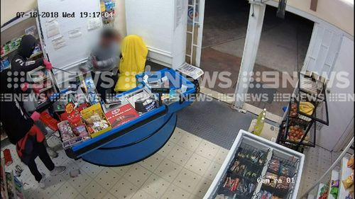 The two men entered the shop in Sydney's west at about 7.30pm last night.