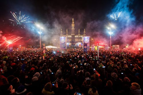 Fireworks explode in front of Vienna's city hall at the 'New Year's Eve Path' in Vienna, Austria
