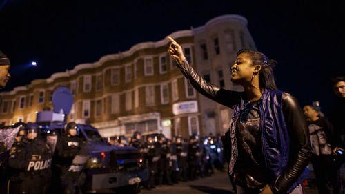 Protesters defy police in Baltimore. (AFP)