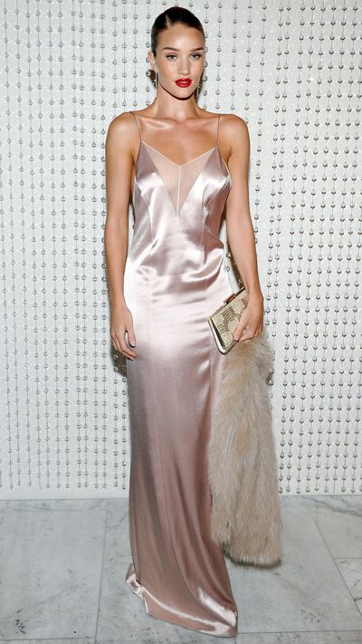 """Rosie Huntington-Whiteley stepped out in Los Angeles overnight for a dinner in celebration of Galvan's upcoming collection for Opening Ceremony, brandishing her general prowess and this insanely good slip dress by the brand. So good was the latter, we momentarily didn't notice that in every picture, she was expertly concealing her <a href=""""http://honey.ninemsn.com.au/2016/01/11/17/12/rosie-huntington-whiteley-engaged"""" target=""""_blank"""">new engagement ring</a> (we're guessing so as not to rub it in our faces, which is kind and very humble). Click through to see other celebrities who've made the full-length slip dress look like so much more."""