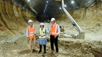 Transport Minister for NSW Rodd Staples (right), NSW Premier Gladys Berejiklian (center), and Transport and Infrastructure MP for NSW Andrew Constance are seen beneath Barangaroo where construction of the Barangaroo Metro is taking place in Sydney, Thursday, March 21, 2019.