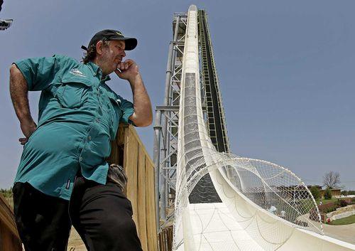 Jeffrey Henry poses beside the waterslide he designed. (AP)