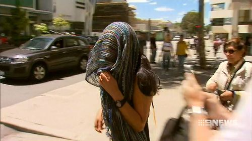 Day care operator Karla Zablah leaving court yesterday. (9NEWS)