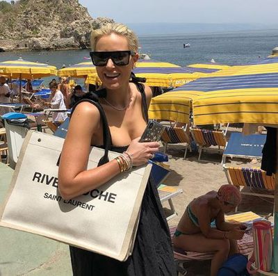 Roxy Jacenko with a Saint Laurent bag and Nicholas Haywood necklace in Taormina, Sicily