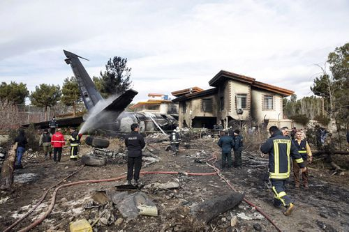 Fire crews worked to extinguish flames after a cargo plane crashed near Fath Airport in the city of Karaj, Iran.
