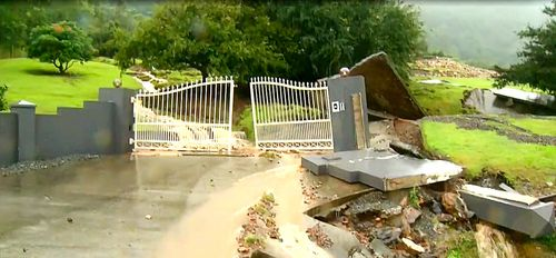 A teetering Gold Coast hinterland property are among  concerns as a result of Queensland's heavy wet weather.