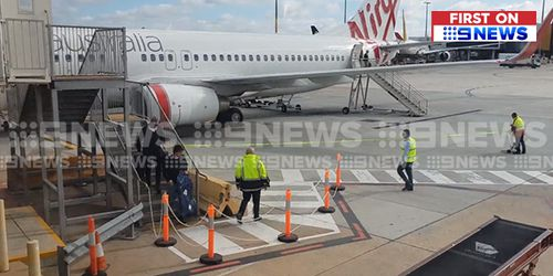 Andrew Gaff on the tarmac at Melbourne Airport earlier today. Picture: 9NEWS