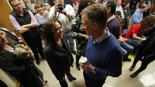 Kamala Harris and John Hickenlooper, seen herer chatting at a Iowa function, are both running for president.