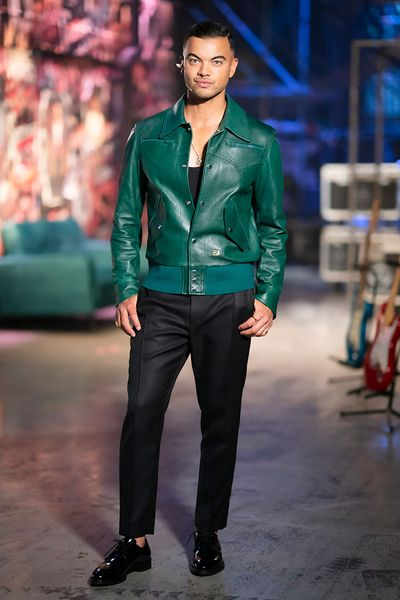 Open green leather jacket with classic pants