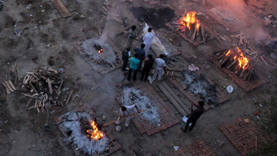 A view of a crematorium ground where mass cremation of victims who died due to the coronavirus disease is seen at a crematorium in New Delhi.