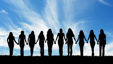 Girls holding hands in a row