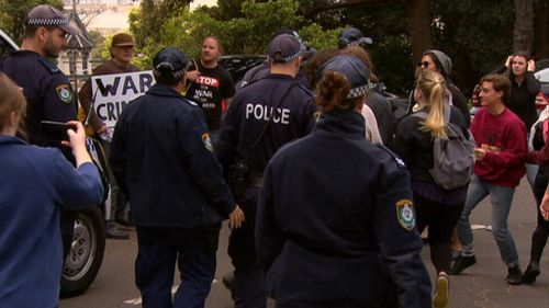 Police responded to the rally. (9NEWS)