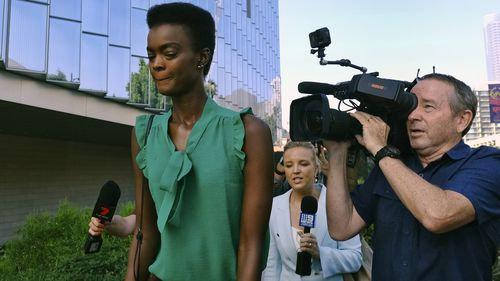 Australian-South Sudanese model Adau Mornyang arrives at the Federal Courthouse in downtown Los Angeles to learn her fate.