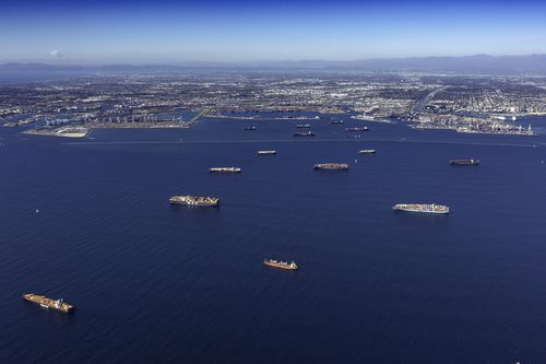 A log jam of container ships moored off the Los Angeles and Long Beach ports in California, US.