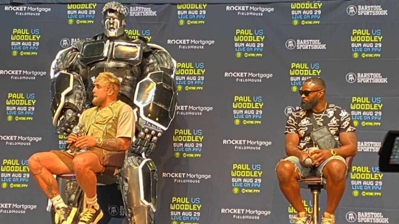 Jake Paul was accompanied by a giant robot chair as he fronted media at his press conference.