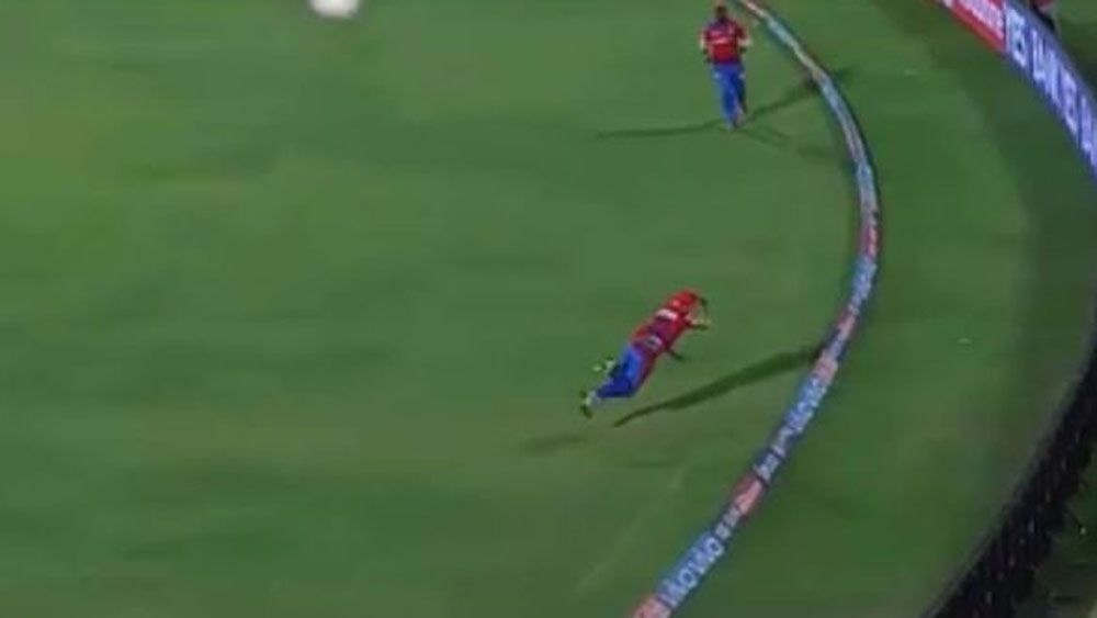 Floppy hat denies Brendon McCullum a stunning catch to dismiss Chris Gayle in IPL