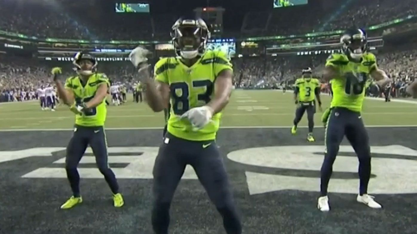 The Seattle Seahawks celebrate after a 60 yard touchdown by David Moore