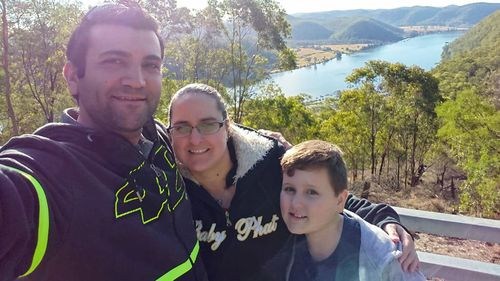 Ms Parkinson, her partner Domenic and son Leo.