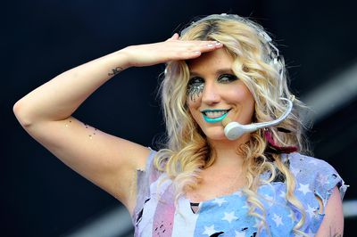We salute you Ke$ha and your bold lip choice.