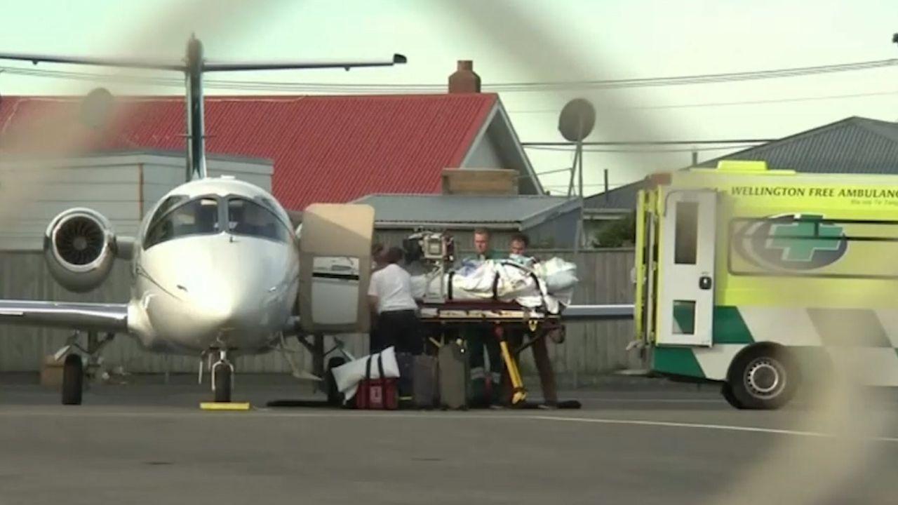 Critically injured Aussie volcano survivors airlifted home