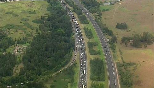 Sydney news Hume Highway crash car caravan