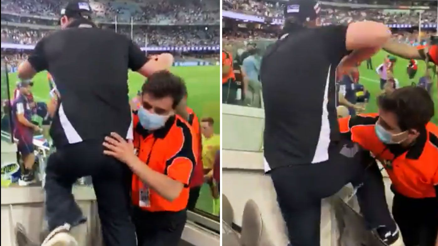 'Super scary' scenes sour AFL thriller as security hold back Pies fan from umpires