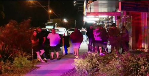 The shooting caused a number of people to spill onto the street last night. (9NEWS)