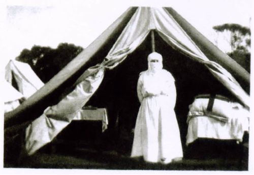 Nurses at Woodman Point Quarantine Station wearing a protective mask