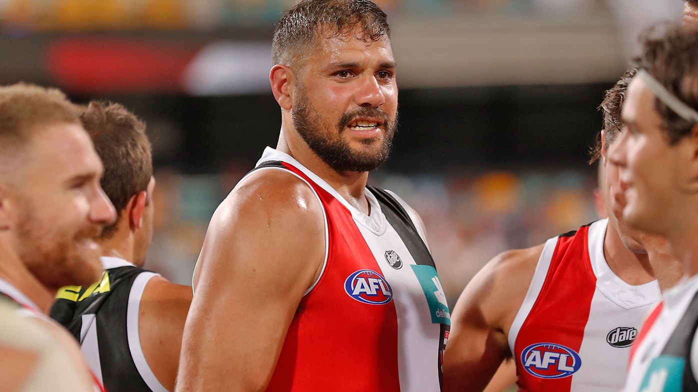 Paddy Ryder of the Saints is consoled by teammates after injuring himself