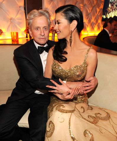Michael Douglas and Catherine Zeta-Jones attends the 2013 Vanity Fair Oscar Party hosted by Graydon Carter at Sunset Tower on February 24, 2013 in West Hollywood, California.