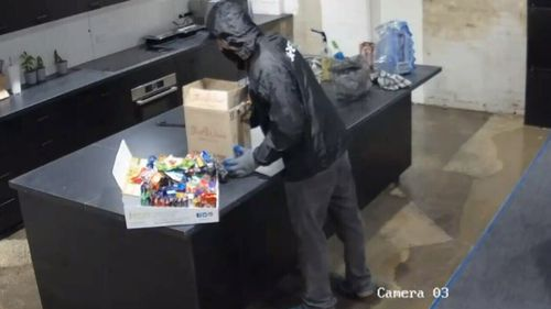 The pair made off with computers, a phone, a camera and some chocolates. (Victoria Police)
