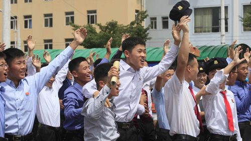 North Koreans cheer the latest test on the streets of Pyongyang. (AAP)