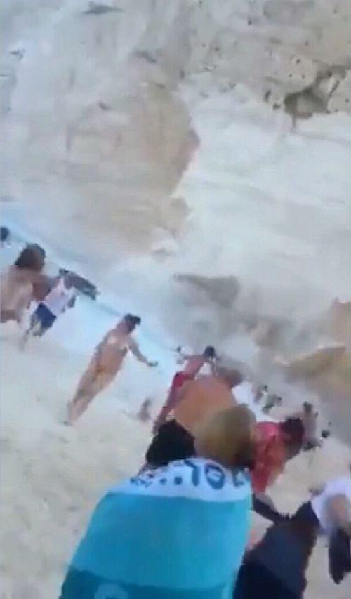 Video footage shows terrified beach goers running.