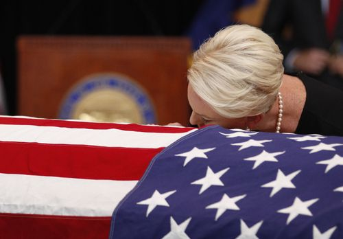 Cindy lays her head on the casket of her All-American hero John McCain.