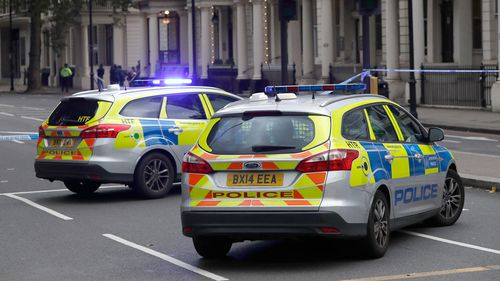 Emergency services outside the Natural History Museum in London. (AAP)